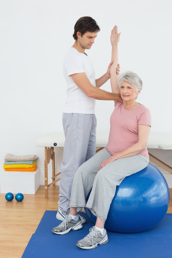 A caregiver offering exercise for elders with disabilities